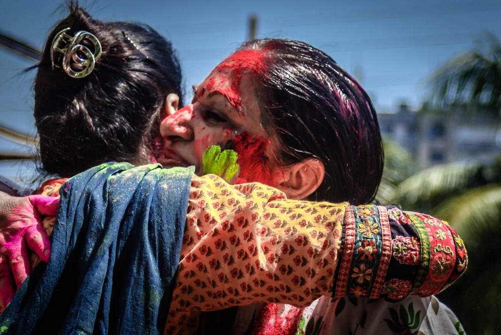 Women embracing at Holi