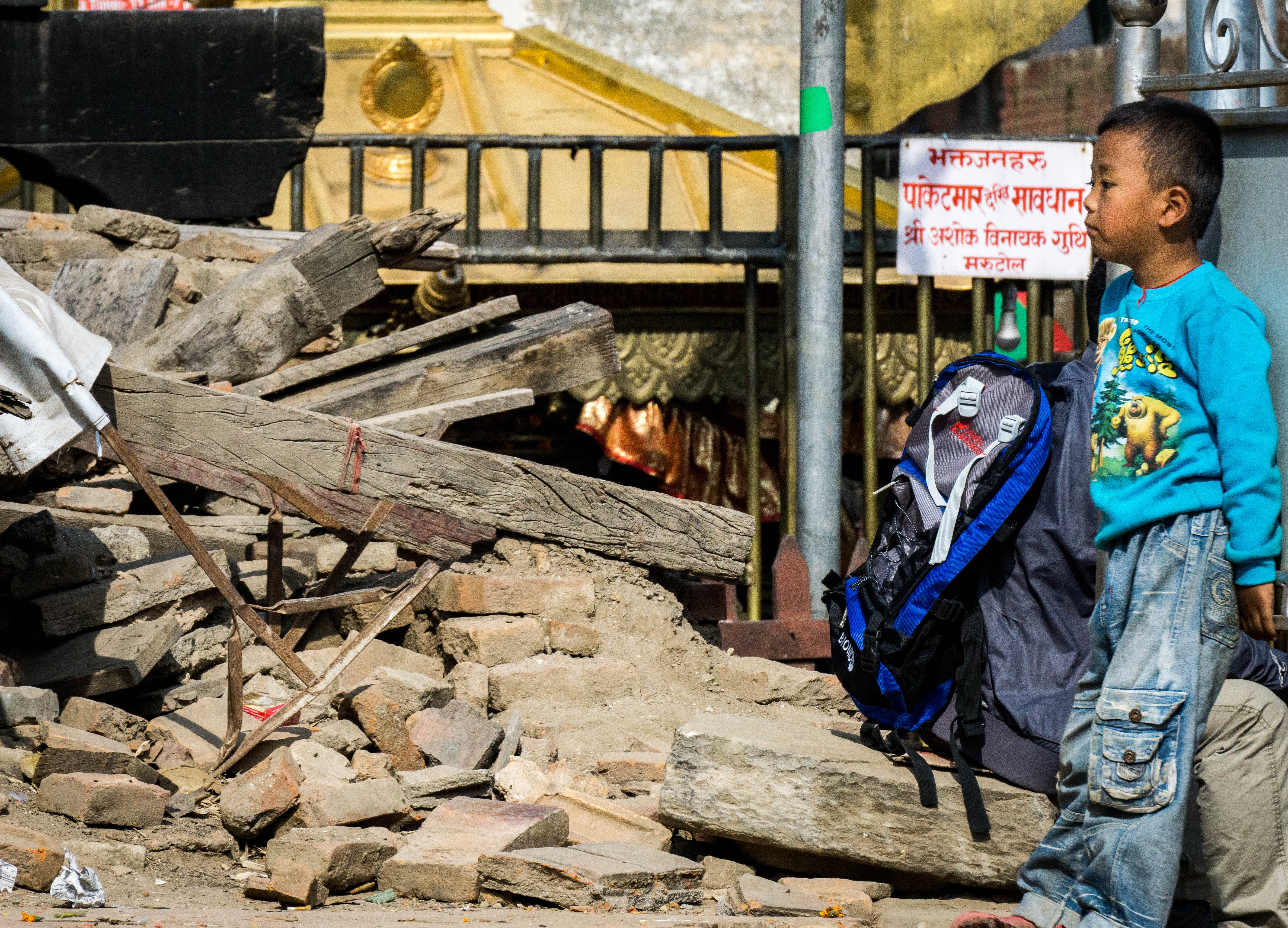 Child stands in rubble, Durbar Square, Kathmandu