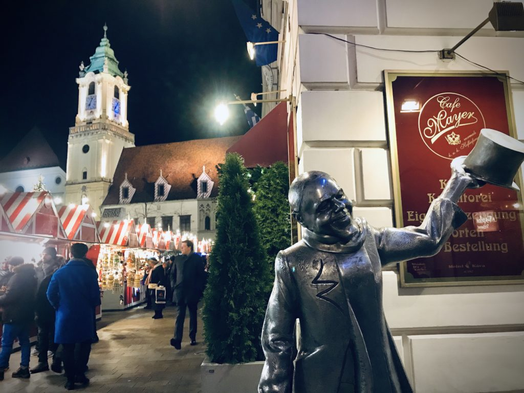 Statue welcoming visitors to Bratislava Christmas Markets